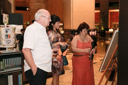 guests looking at poster
